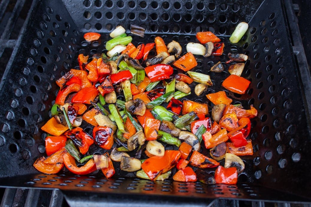 grilled vegetables in grill basket on the grill