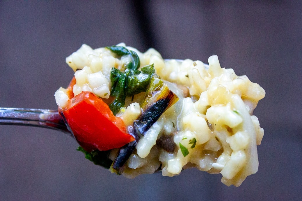 one forkful of instant pot risotto with grilled vegetables