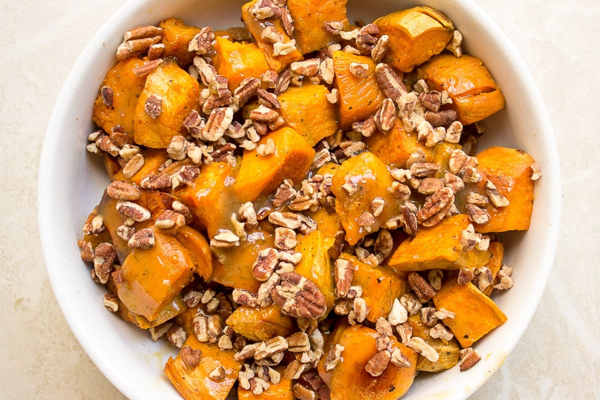 bowl of maple sweet potatoes with pecans