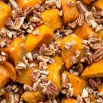 bowl of glazed sweet potatoes with pecans p1
