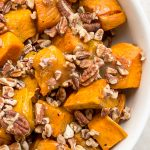 bowl of glazed sweet potatoes with pecans p2