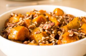 Maple-Lime Roasted Sweet Potatoes with Pecans in a bowl f