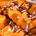 bowl of glazed sweet potatoes with pecans p