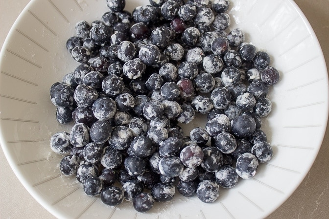 blueberries dusted in flour in bowl