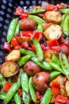 grilled veggies and potatoes in grill basket p5
