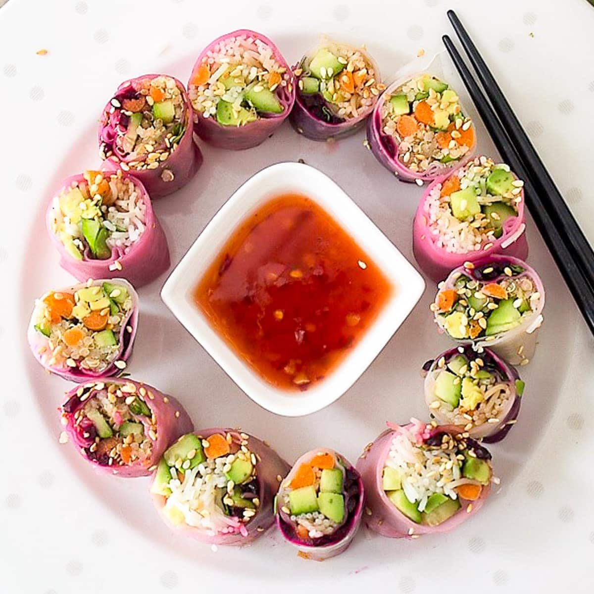 Summer Vegetable rice paper Rolls cut in two on a plate