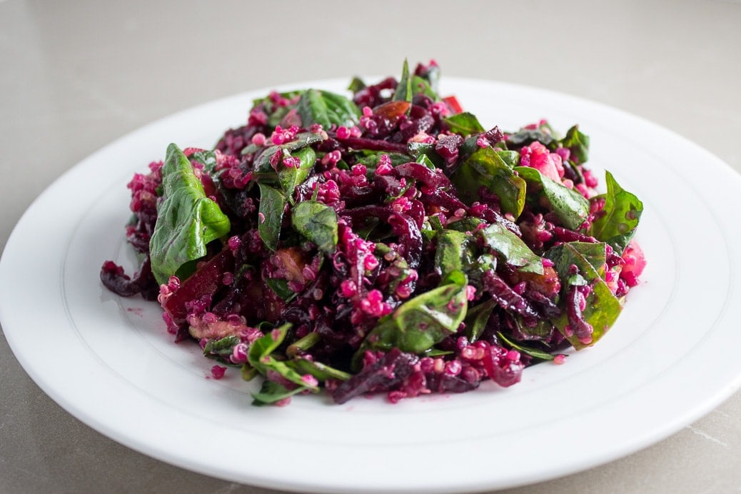 Vibrant Beet, Spinach and Quinoa Salad. Colourful, nutritious and versatile with nuts, apples and goat cheese.