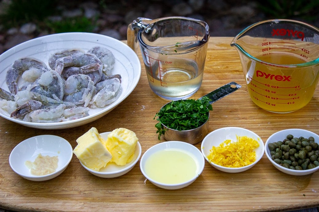 raw shrimp, wine, broth, lemon zest and juice, butter, flour, parsley, capers