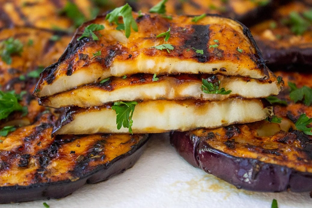 3 slices grilled eggplant stacked cut open to show inside