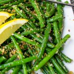 green beans with lemon garlic panko on a plate with lemon wedges p1