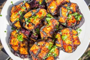 plate of sliced glazed grilled eggplant f