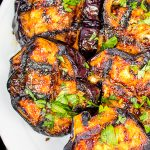 grilled eggplant slices on a plate p2