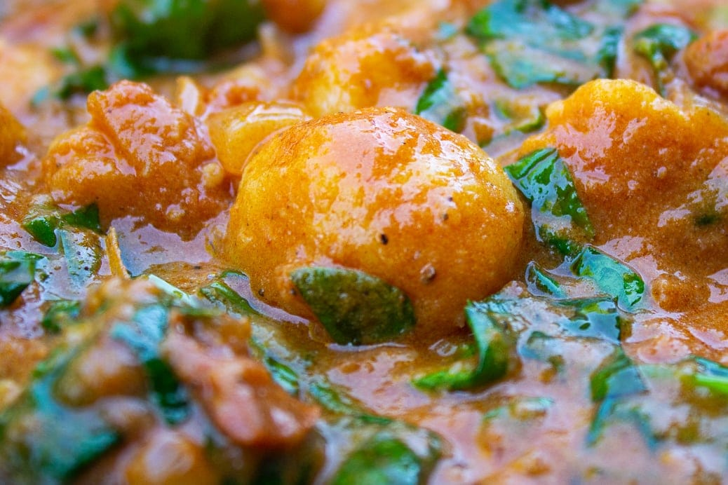 close up of gnocchi indian style in pan
