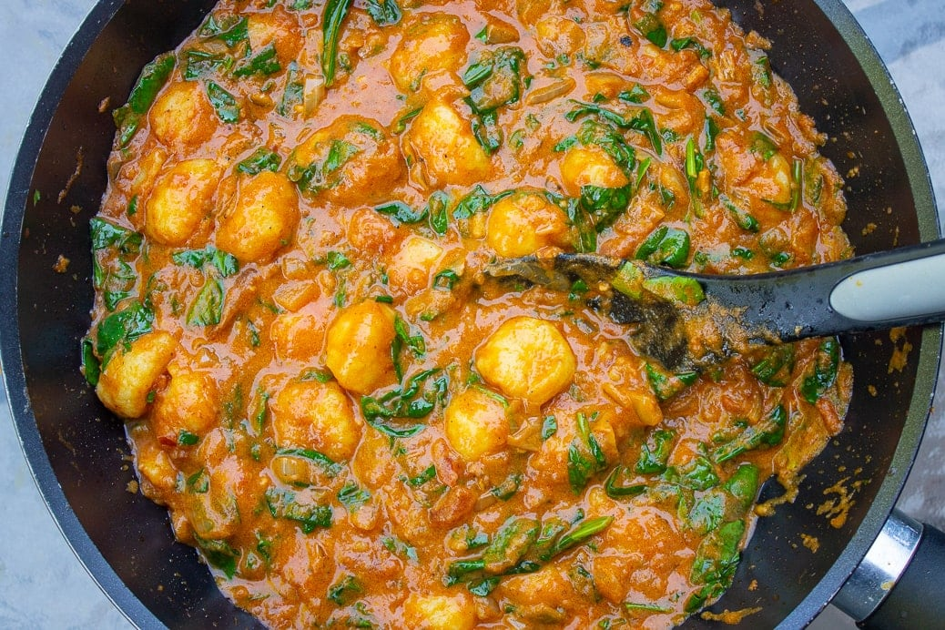 Indian style Gnocchi with spinach in pan 2