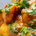 Indian style Gnocchi with Spinach in bowl sprinkled with parsley p