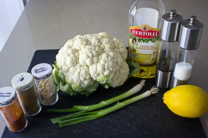 cauliflower, oil, seasonings, green onion, lemon