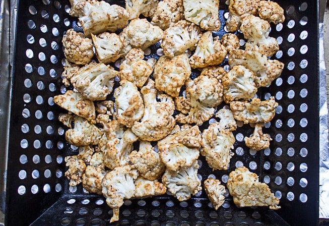 seasoned Cauliflower in grill basket ready to grill
