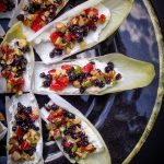 Endive Appetizers fanned out on a black plate