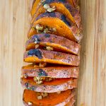 one Grilled Hasselback Sweet Potato on cutting board p