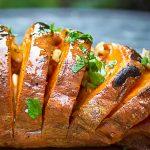 Grilled Hasselback Sweet Potato on cutting board p3