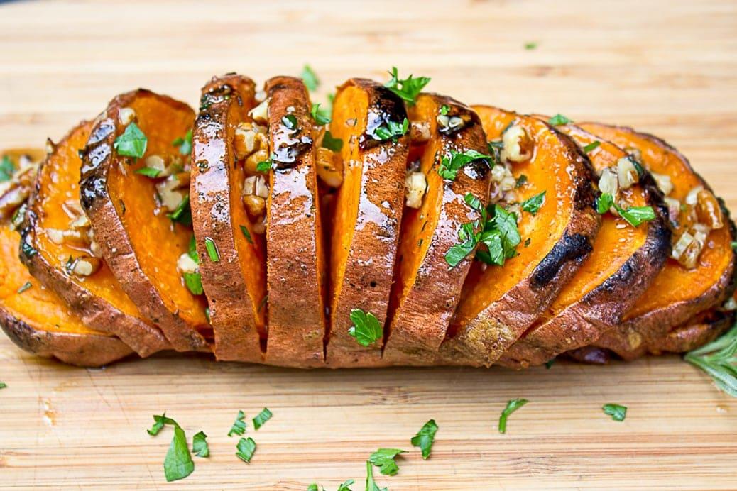 Grilled Hasselback Sweet Potato on cutting board 3