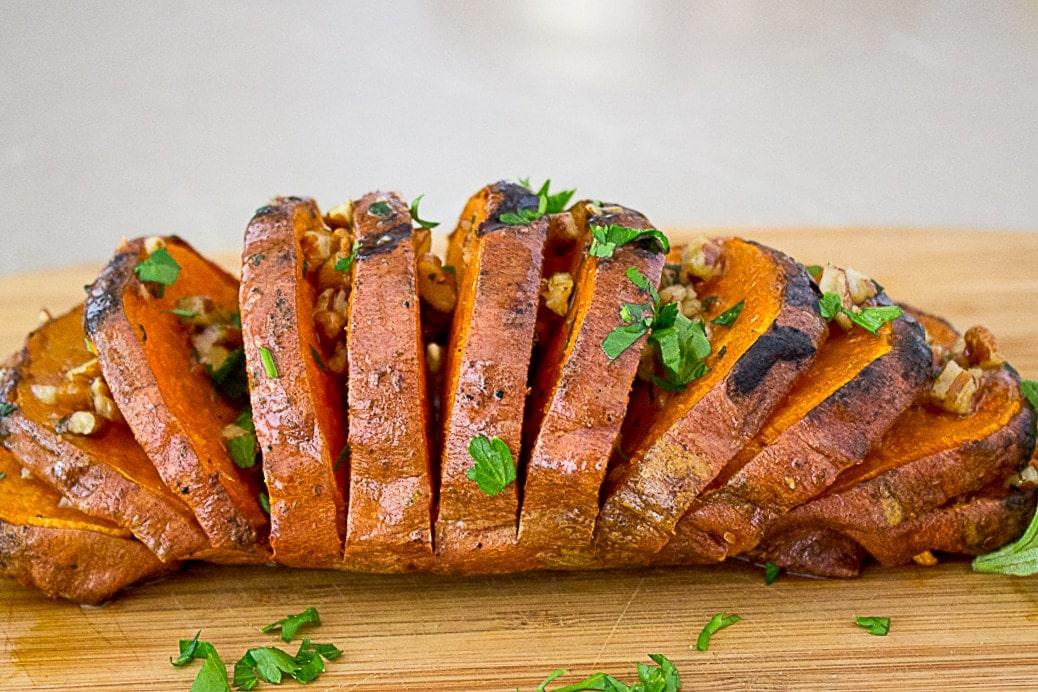 Grilled Hasselback Sweet Potato on cutting board