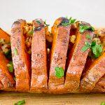 Grilled Hasselback Sweet Potato on cutting board p4