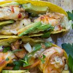 2 Grilled shrimp tacos with coconut lime chili sauce on platter p2
