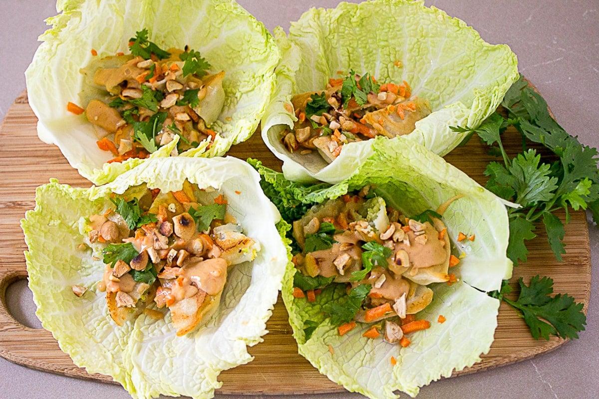 lettuce wraps with dumplings on cutting board 1