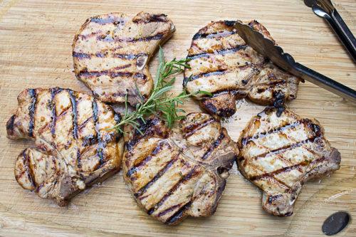 grilled pork chops on cutting board 2