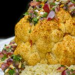 Roasted Cauliflower with Grape Relish laid on quinoa on plate