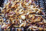Grilled Charred Onions in a grill basket f