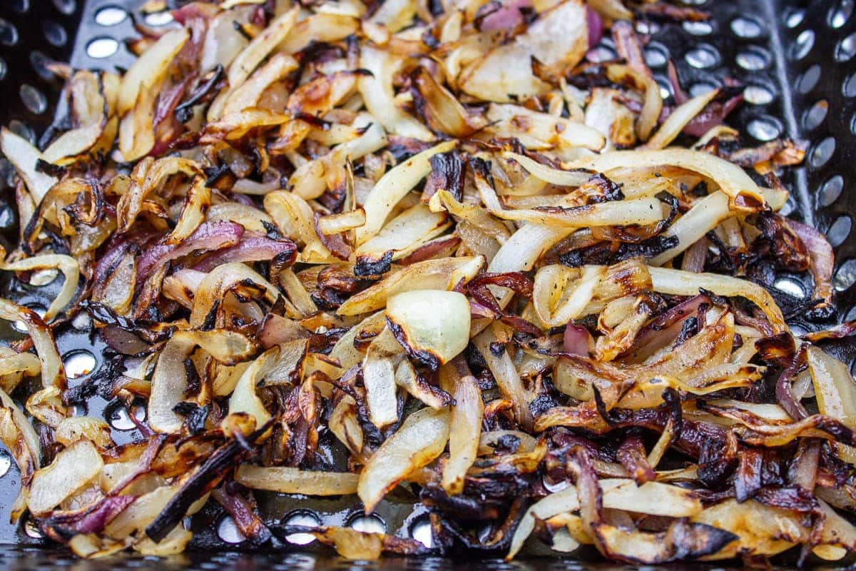 charred onions in grill basket