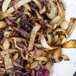 grilled charred onions in a bowl p1