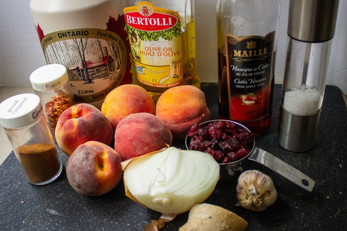 peaches, onion, cranberries, garlic, ginger, maple syrup, oil, chili flakes, apple cider vinegar