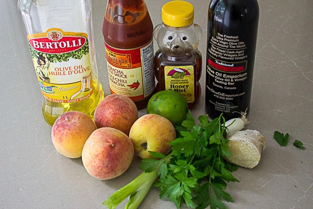 salsa ingredients - peaches, balsamic, honey, lime, green onion, parsley, oil, sriracha