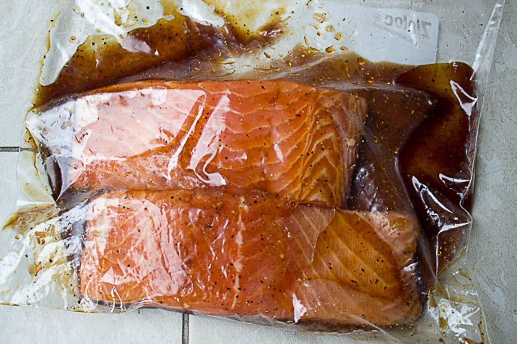 salmon fillets mainating in zip locked bag