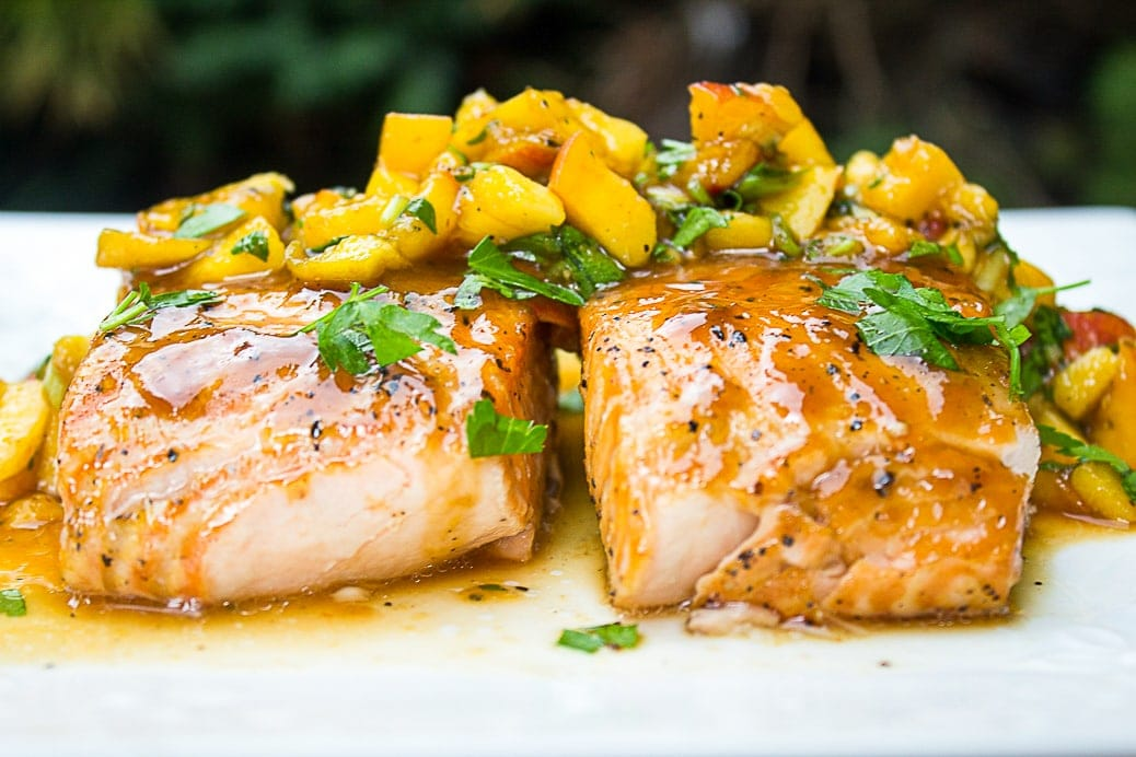 2 maple salmon with peach salsa on plate