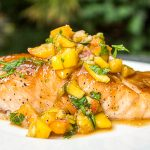 one maple salmon with peach salsa on plate f
