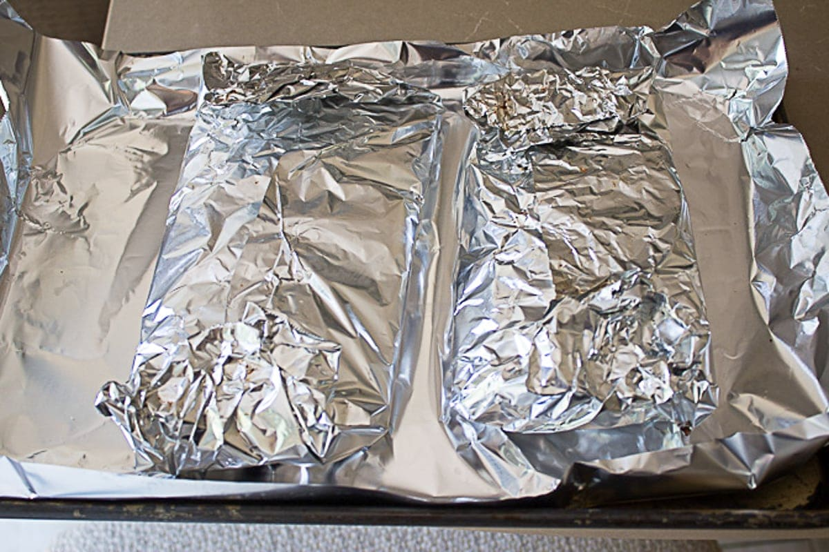 ribs wrapped in foil ready to bake