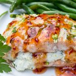 Salmon Stuffed With Lemon Ricotta drizzled with sweet chili sauce on plate with beans p3
