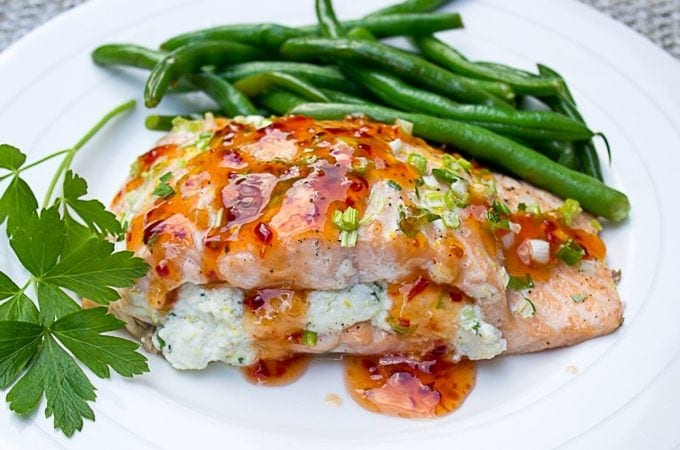 Salmon Stuffed With Lemon Ricotta drizzled with sweet chili sauce on plate with beans ff