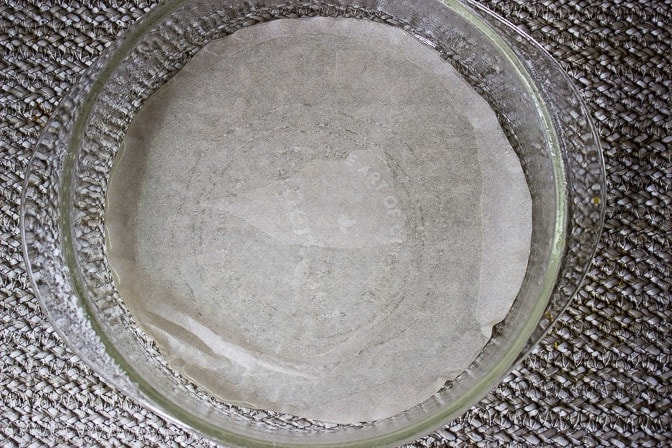cake dish with parchment paper cut out to cover bottom