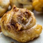 cinnamon puff pastry rolls on serving board
