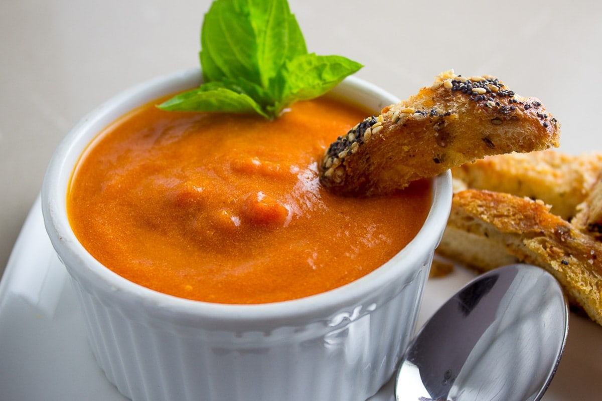Homemade creamy tomato soup in bowl with crouton in it 2