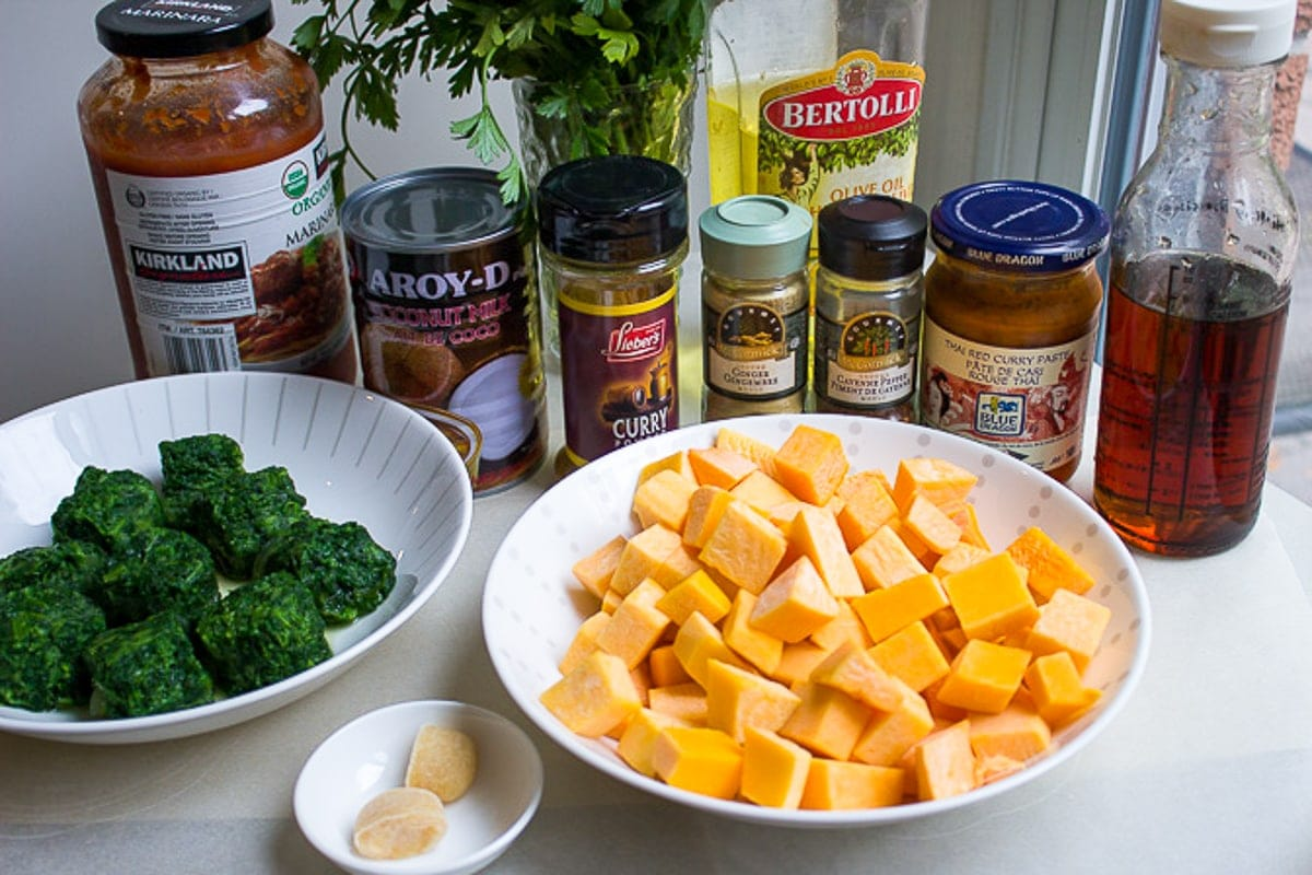 cubed butternut squash, frozen spinach, coconut milk, curry, ginger, garlic, oil, curry paste, maple syrup, tomato sauce