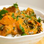 Tomato Squash Curry over rice in a bowl p2