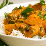 Tomato Squash Curry over rice in a bowl p1