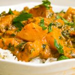squash curry over rice in bowl p