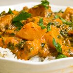 Tomato Squash Curry over rice in a bowl p